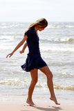Beach. The girl on coast of a gulf Stock Images