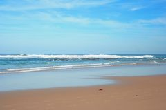 Beach. Sunny day on South African beach with big waves and clear blue sky stock photos