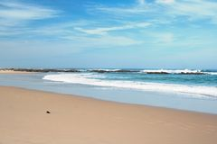 Beach. Sunny day on South African beach with big waves and clear blue sky Royalty Free Stock Images