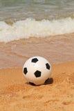 Beach. A football on the Beach stock photos
