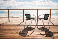 At the beach. Chairs at a beach in italy Royalty Free Stock Image