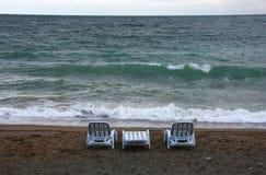 Beach. Three plastic chaise-lounge on the beach Royalty Free Stock Photo
