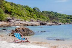 A beach. An empty beach with a chair and nobody around Royalty Free Stock Image