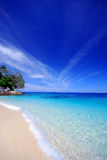Beach. Scenery with clear cyrstal water and blue sky - Taken in Redang island, Malaysia Royalty Free Stock Image