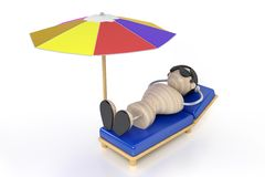 Beach. Man lies on a deck-chair and zagoraet Royalty Free Stock Image