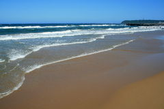 Beach. Golden beach with tide coming in Royalty Free Stock Photography