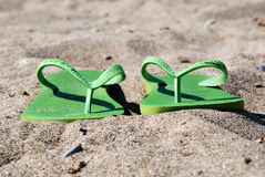 At the beach. Beach vacation sandals in the sun Stock Photos