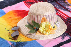 On a beach. Towel, hat and solar glasses on a beach Royalty Free Stock Photography