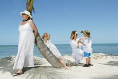 On the Beach. Two women with their children enjoying their tropical vacation in Florida Royalty Free Stock Image