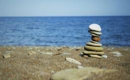 Beach. Balanced stones on a beach royalty free stock photography