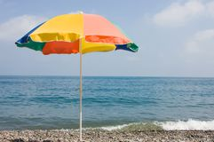 Beach. Color beach umbrella on a background of the sea Royalty Free Stock Photo