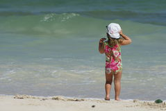 On the beach. Two years old girl watching sea waves Royalty Free Stock Photo