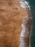 Beach. Couple walking on the beach stock photo