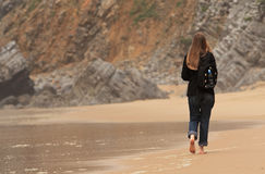 On the beach. Girl walking on the beach stock photography