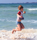 On the beach. A young boy is playing on the beach Stock Photos