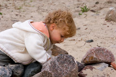 At the  beach. Little girl playing on the beach Stock Image