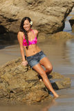 At the Beach. Young Hawaian beauty at the beach in shorts and halter top Stock Photos