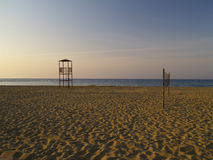 On the beach. Lifeguard´s tower on a lonely beach in the evening Stock Photos