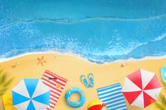 Beach from above. Parasols, palms, towels, cocktails, glasses, slippers on the beach Stock Image