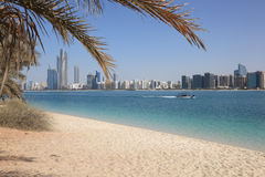 Beach in Abu Dhabi. Beach and the skyline of Abu Dhabi, United Arab Emirates royalty free stock photo