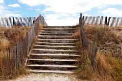 Beach access over protective dunes Royalty Free Stock Photos