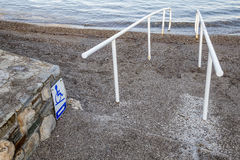 Beach access and sign for the disabled Royalty Free Stock Image