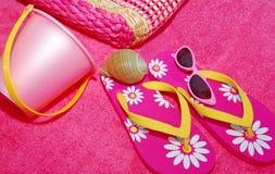 Beach Accessories. Pretty pink beach bag, sandals, sunglasses, sand pail, and seashell Stock Photos