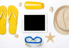 Beach accessories around tablet with copy space on white backgro Royalty Free Stock Photos