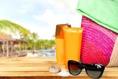 Beach accessories. Summer fun background beach stuff tan Stock Photo
