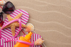 Beach accessories for the beach lying on the sand Stock Photos