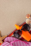 Beach accessories for the beach lying on the sand Stock Images