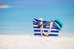 Beach accessories - blue bag, straw hat Stock Photo