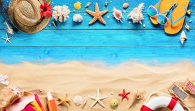 Beach Accessories On Blue Plank And Sand. Summer Holiday Background Royalty Free Stock Image