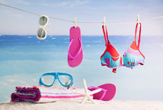 Beach accessories, on blue sea background Royalty Free Stock Photography