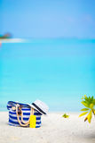 Beach accessories - blue stripe bag, straw hat Royalty Free Stock Image