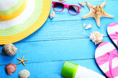 Beach accessories on blue wooden background Stock Photos