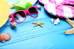Beach accessories on blue wooden background Royalty Free Stock Photography