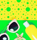 Beach accessories on a bright colorful background. Dried starfish, trendy pink sunglasses and a bottle of sunscreen lotion. Summer. Vacation background.Top view royalty free stock photos