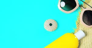 Beach accessories on a bright green colorful background. Trendy pink sunglasses, a bottle of sunscreen lotion, a fragment of a. Straw hat and sea urchin shell stock photo