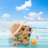 Beach accessories and drink. Tropical vacation on Stock Images