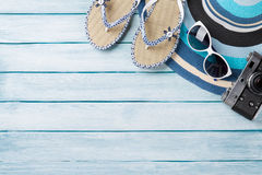 Beach accessories. Flip flops, camera, hat and sunglasses Royalty Free Stock Photo