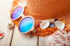 Beach accessories glasses hat cockleshells.  Royalty Free Stock Images