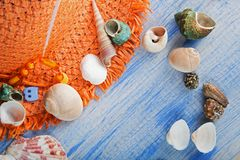 Beach accessories glasses hat cockleshells.  Royalty Free Stock Image
