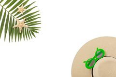 Beach accessories green color with tropical palm leaves on isola. Ted background with empty space for text. Flat lay, top view Royalty Free Stock Image