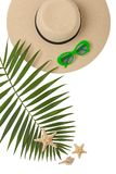 Beach accessories green color with tropical palm leaves on isola. Ted background with empty space for text. Flat lay, top view Stock Photography