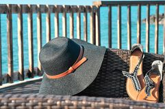 Beach accessories hat and sandals royalty free stock photos
