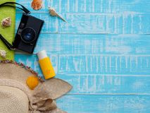 Beach accessories including sunscreen, hat beach, shell and retr royalty free stock image