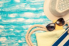 Beach accessories. Lie on a blue wooden background Stock Photography
