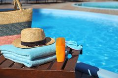 Beach accessories near swimming pool. On sunny day royalty free stock photo