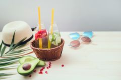 Beach accessories, palm leaf and refreshing drinks. royalty free stock photos